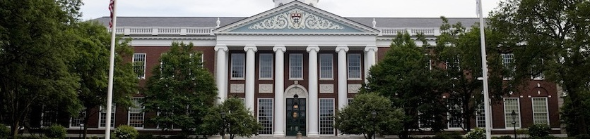 The Harvard Business School Baker Library faces the Charles River in Boston, Massachusetts, U.S., on Sunday, June 26, 2011. Photographer: Kelvin Ma/Bloomberg